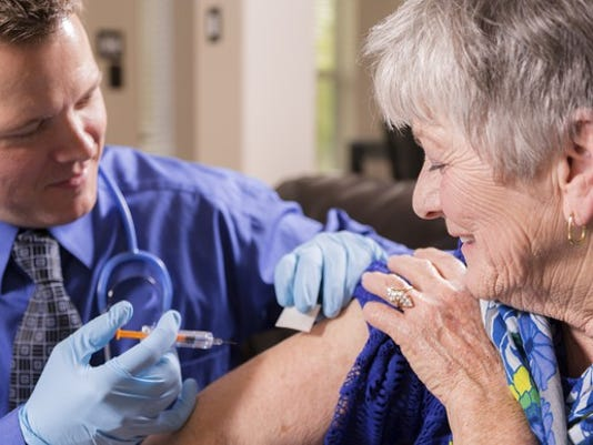 doctor-giving-vaccine-flu-shot-to-senior-getty_large.jpg