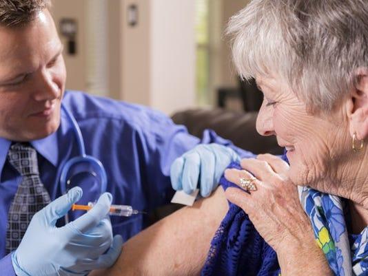 doctor-giving-vaccine-flu-shot-to-senior-getty_large.jpg