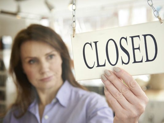 woman-with-closed-sign-on-shop-door-getty_large.jpg