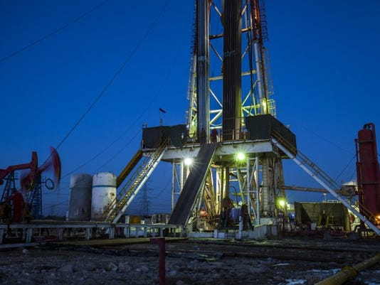 an-oil-drilling-rigs-with-pump-jacks_large.jpg