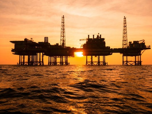 getty-offshore-oil-rig-silhouette-sunset_large.jpg