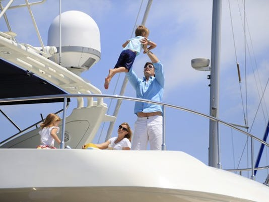 family-on-yacht_gettyimages-527816247_large.jpg