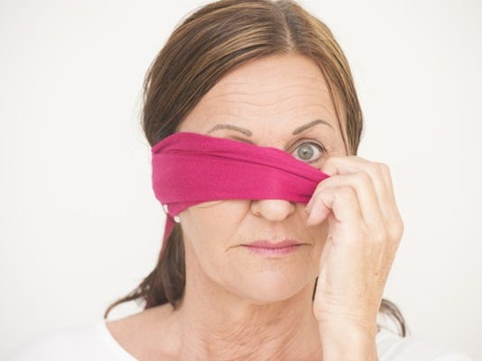 mature-woman-removing-blindfold_large.jpg