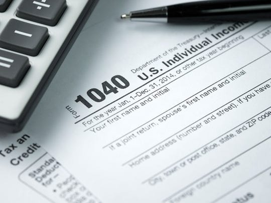 File photo shows image of IRS Form 1040 tax return