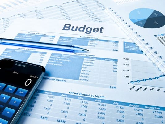 budget-figures-with-calculator-and-pen-getty_large.jpg