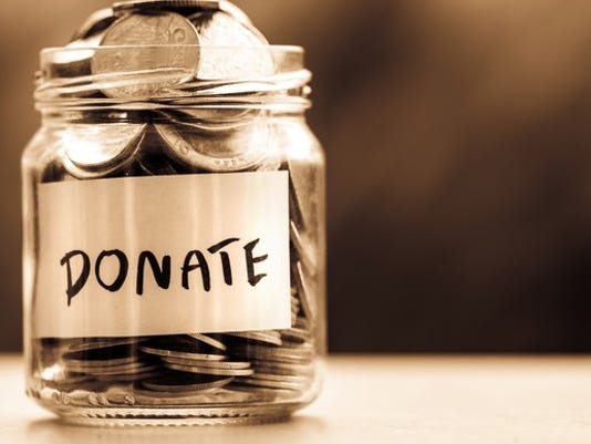 glass-jar-full-of-cois-with-donate-written- - Christmas 2017: Need Gift Ideas? How About A Charity Donation?