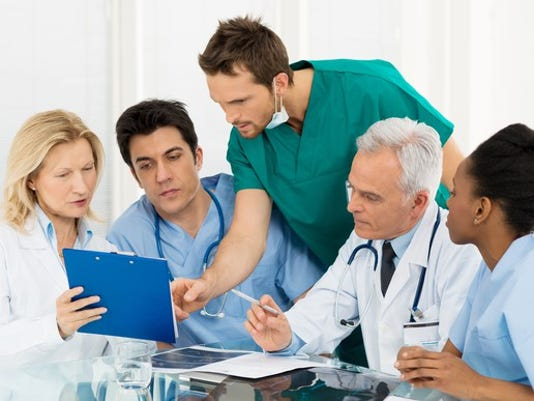 team-of-doctors-looking-over-data_large.jpg