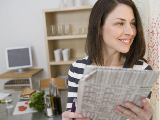 woman-with-financial-newspaper-getty_large.jpg