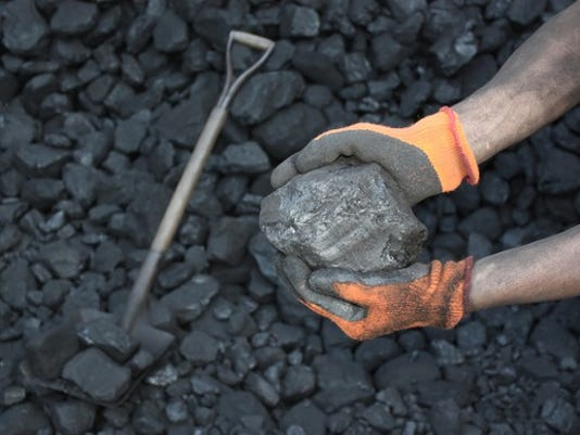 coal-in-the-hands-of-a-miner_large.jpg