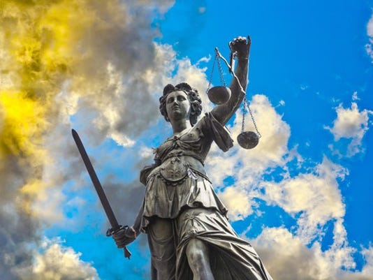 lady-justice-in-the-clouds_large.jpg