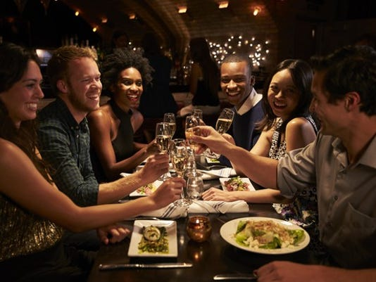 restaurant-dining-out-eating-friends-party-drinking-toast-getty_large.jpg
