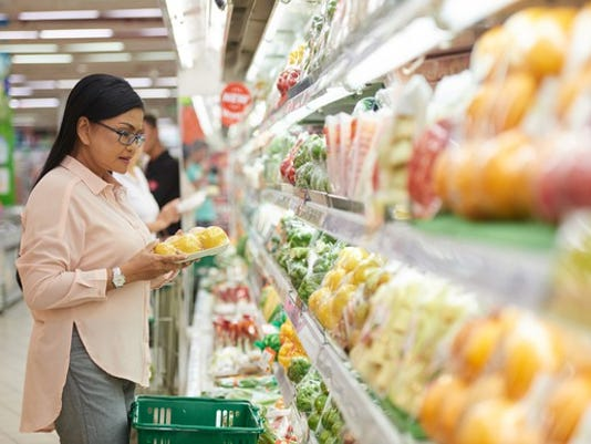 mature-senior-woman-in-grocery-store-looking-at-produce-poc_large.jpg