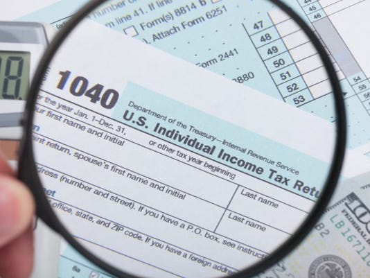 tax-form-1040-magnifying-glass-audit-irs-law-eitc-getty_large.jpg