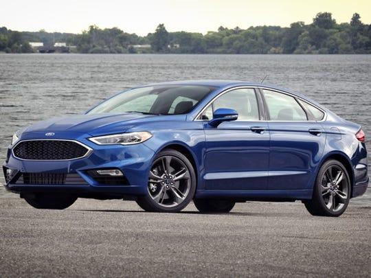 A blue 2017 Ford Fusion Sport midsize sedan.
