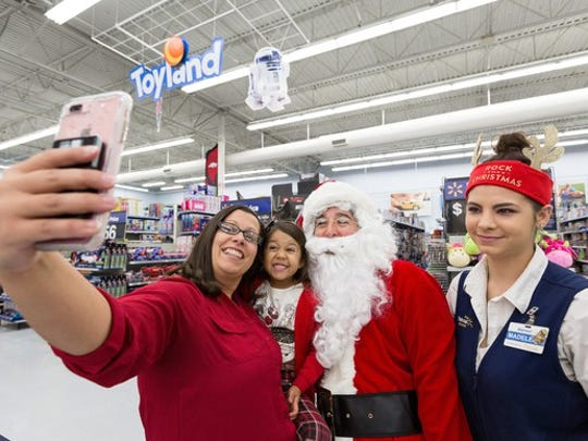Wal-Mart is hosting in-store holiday events to get shoppers through the door, but it's also encouraging online shopping with free shipping.