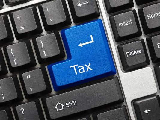 tax-gettyimages-502644390_large.jpg