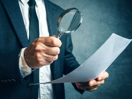 man-inspecting-document-with-magnifying-glass-tax-inspector-irs-agent-audit_large.jpg