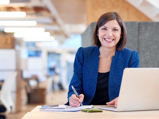 smiling-woman-at-her-desk_gettyimages-530437128_large.jpg