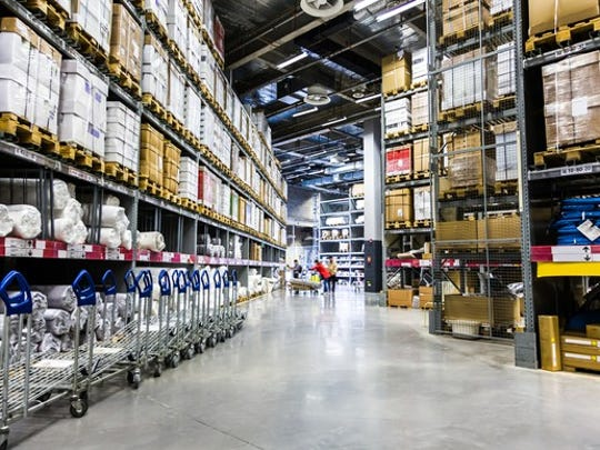 A warehouse with its shelves packed with goods