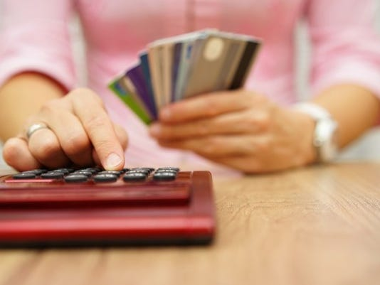 credit-cards-and-calculator_gettyimages-497316392_large.jpg