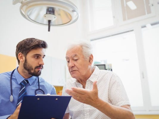 senior-man-talking-to-doctor-holding-clipboard-medical-expenses-healthcare-hospital_large.jpg