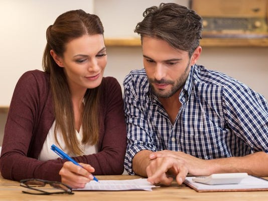 young-couple-creating-budget_gettyimages-505472368_large.jpg