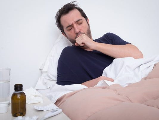 man-sick-in-bed_gettyimages-653442810_large.jpg