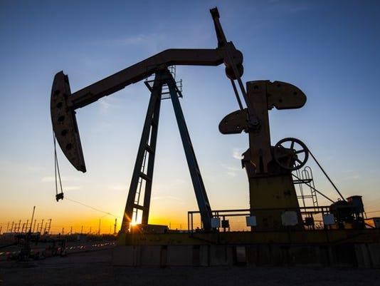 a-beam-of-light-shining-through-an-oil-pump-at-sunset_large.jpg
