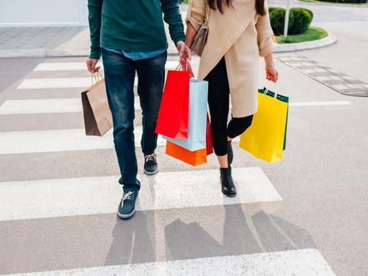 couple-carrying-shopping-bags_gettyimages-528957012_large.jpg