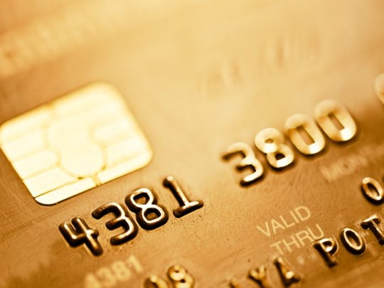 A gold-colored credit with the EMV chip prominently displayed.