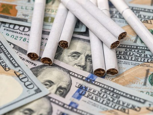 cigarette-money-taxes-costs-smoking-source-getty_large.jpg