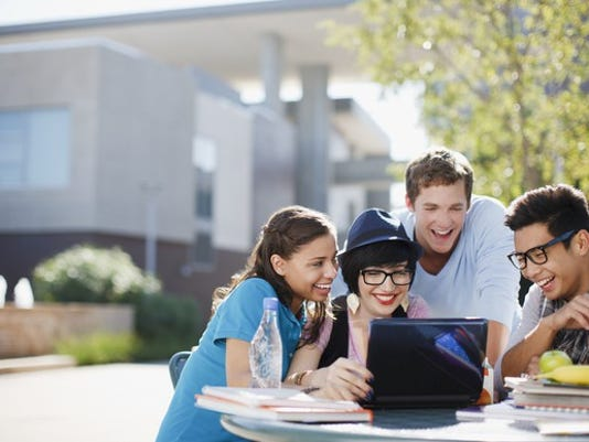college-students-young-adults-millennials-using-laptop-outside_large.jpg