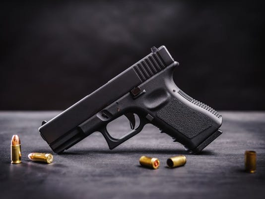 handgun-with-bullets_large.jpg