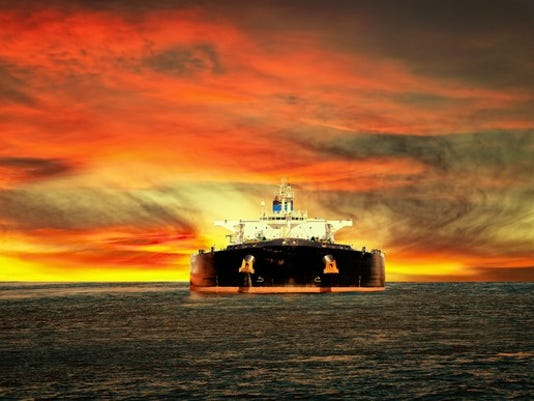oil-tanker-ship-at-sea-on-a-background-of-sunset-sky_large.jpg
