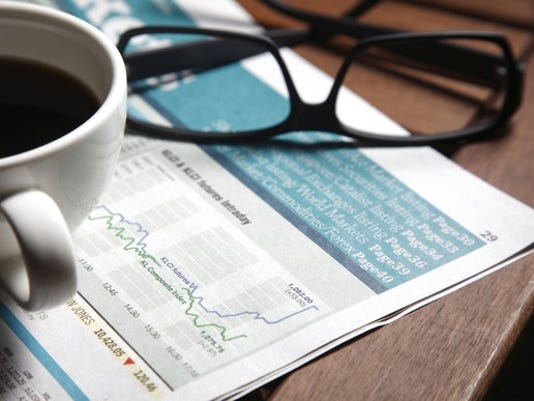 financial-newspaper-with-coffee-mug-and-spectacles-sitting-on-top-of-it-investing-markets-media-finance_large.jpg