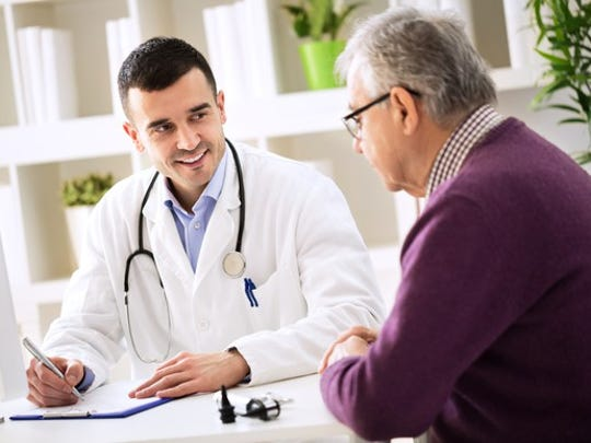 doctor talking to senior man