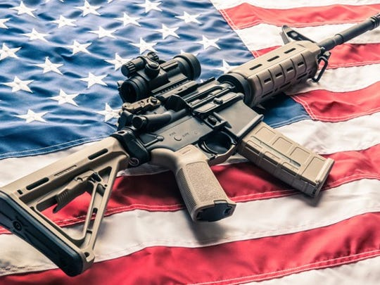 Modern sporting rifle lying on American flag