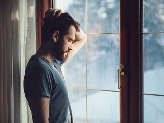man-staring-out-window_gettyimages-638779972_large.jpg