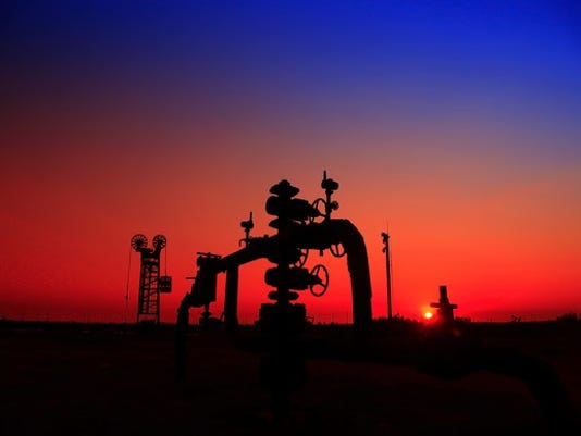 a-natural-gas-well-with-pipelines-at-sunset_large.jpg