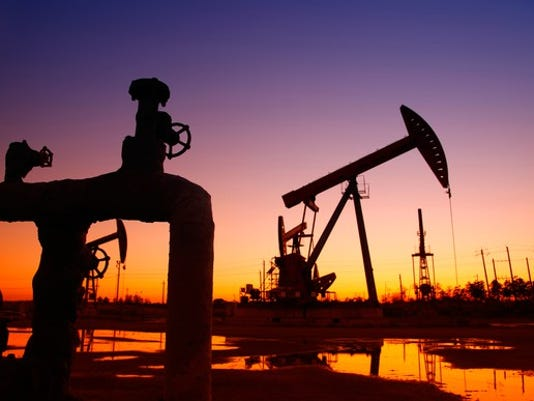 a-pipeline-and-an-oil-pump-at-sunset_large.jpg