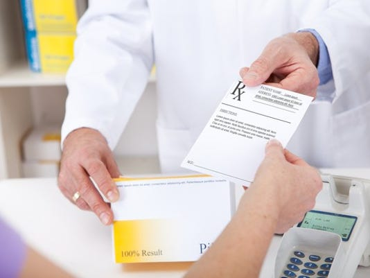 pharmacist-with-a-prescription-gettyimages-473445110_large.jpg