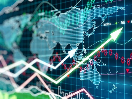 Stock market charts and prices overlaying a world map