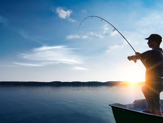 man-fishing-from-boat-on-a-bright-sunny-day_large.jpg