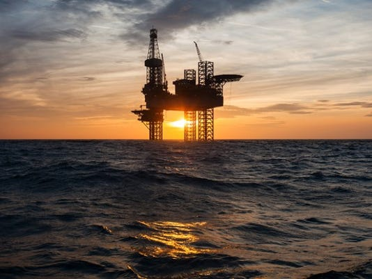 silhouette-of-an-offshore-oil-drilling-rig_large.jpg