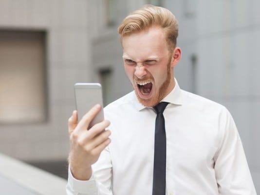 man-yelling-at-cellphone_large.jpg