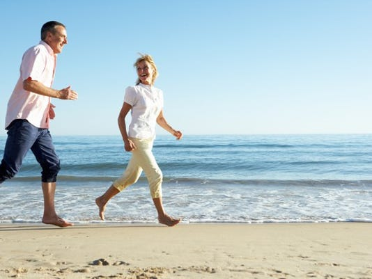 mid-aged-couple-running-along-the-beach_gettyimages-177774273_large.jpg