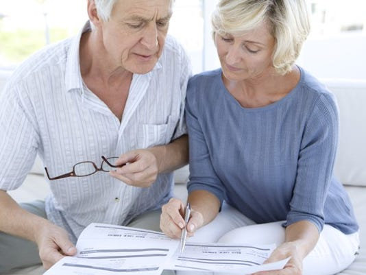 senior-couple-looking-at-paperwork_gettyimages-138173092_large.jpg