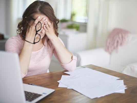 woman-stressed-over-finances_gettyimages-474688148_large.jpg