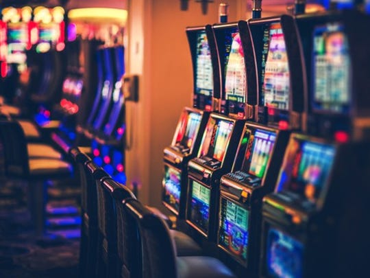 Row of slot machines on a typical casino floor.
