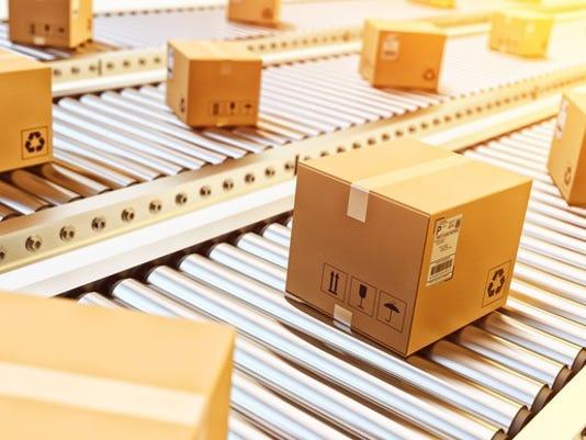 packages-on-conveyor-belt_large.jpg